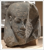 Granodiorite head of a male deity - (c) MSA