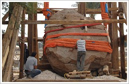 Workers re-erecting the stele of Amenhotep III