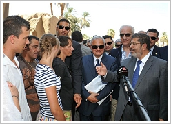 Tourists in conversation with President Mohammed Morsi at Luxor Temple